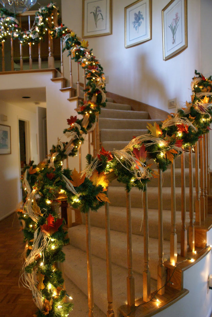 banister decorated for fall christmas